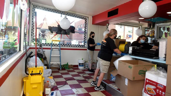 Servpro employees work Wednesday to clean Broadway Diner following an early morning grease fire.  [Don Shrubshell/Tribune]