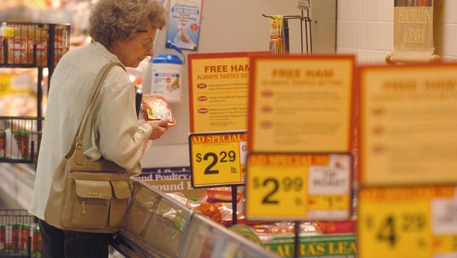 A customer looks over the meat selections at the BI-LO grocery store in Daniel Village shopping center in this file image. On Wednesday the Food Lion supermarket chain announced it would acquire the store as part of an acquisition of 62 BI-LO and Harveys Supermarket stores.