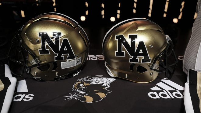 The North Augusta Yellow Jackets show their new helmets as they announce their new head football coach Jim Bob Bryant in North Augusta, SC. on Thursday, February, 13, 2020. [MIKE ADAMS/FOR THE AUGUSTA CHRONICLE] \r