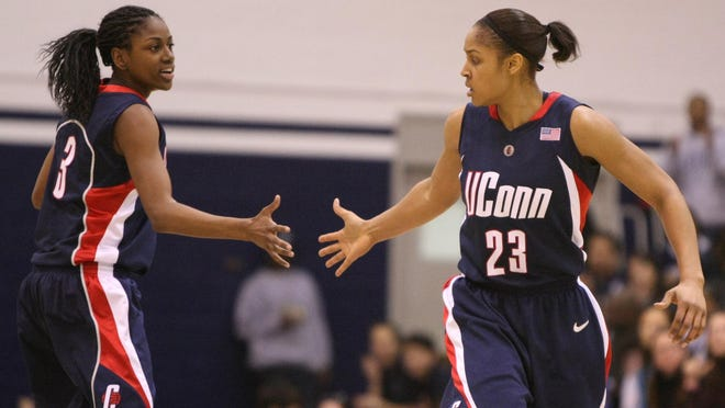 Connecticut's Maya Moore (23) is congratulated by Tiffany Hayes after scoring against Georgetown during a game Jan. 31, 2009 in Washington. Renee Montgomery and Hayes, now with the WNBA's Atlanta Dream, appreciated what former UConn teammate Moore was doing when the All-Star forward stepped away from basketball two years ago to focus on criminal justice reform.