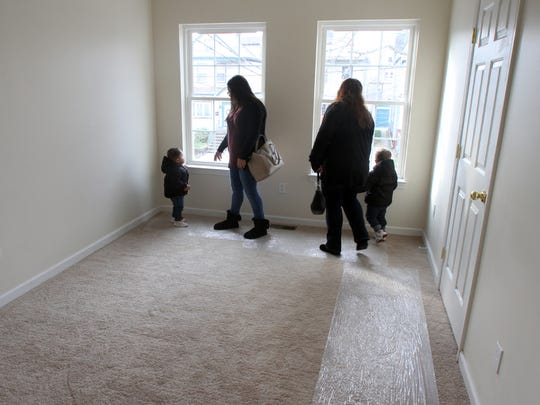 Morris of Habitat for Humanity held a open house dedication of a new home built at 440 Lawrie Street in Perth Amboy. The Mercado family will be moving in to the newly built home.Here Thalia Cardona and her childen Yandell and Yancarlos Almonte look around on the the barrooms of their new home with their grand mother Noris Mercado.