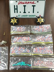 St. Landry Parish Sheriff deputies seized 421 ecstasy tablets and 13 clindamycin hydrochloride pills.