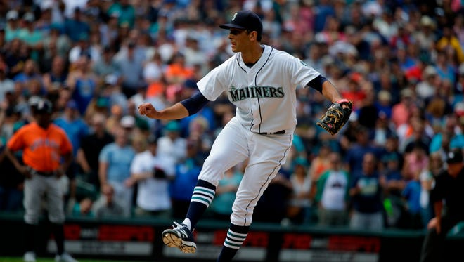 Seattle Mariners relief pitcher Steve Cishek throws against the Houston Astros during a baseball game, Saturday, July 16, 2016, in Seattle.
