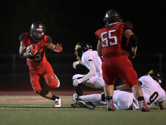 Foothill running back Jeshua Womack goes on a run Friday
