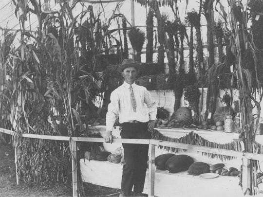 Augusta County farmer Jimmy Bailey stands in front of his first-place exhibit for county agricultural products at the 1916 state fair that was held in Staunton at the Gypsy Hill Park fairgrounds.