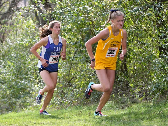 Eastern York's Maddie McLain, right, leads Oley Valley's