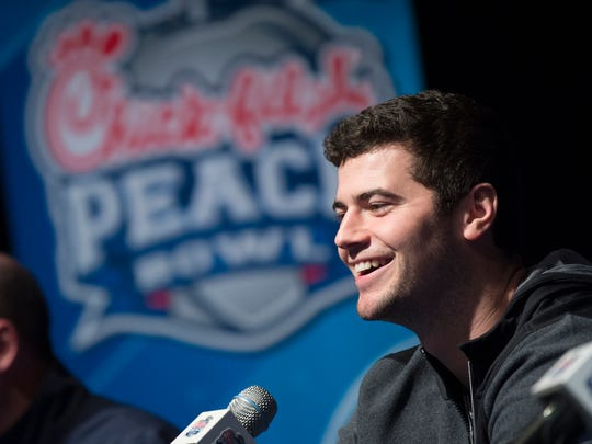 Auburn quarterback Jarrett Stidham (8) speaks during the Auburn's Peach Bowl offensive press conference on Dec. 30, 2107, in Atlanta, Ga.
