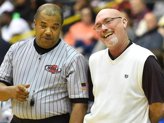 Choctaw Central coach Bill Smith shares a light moment