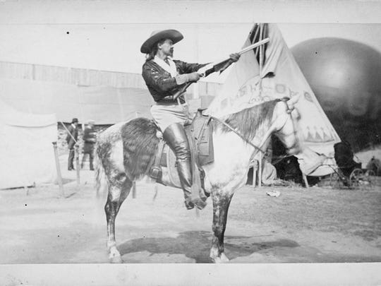This cabinet card from 1883 features Buffalo Bill Cody mounted on a horse.