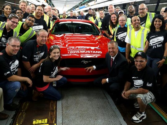 Joe Hinrichs, then-President of the Americas for Ford Motor Company, joined production line employees in front of the first 2015 Ford Mustang GT production sports car at the Ford Motor Company Flat Rock Assembly Plant on Thursday, August 28, 2014.