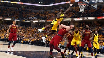 Indiana Pacers guard Lance Stephenson (1) takes a shot against Cleveland Cavaliers forward Kevin Love (0) during the first quarter in game three of the first round of the 2018 NBA Playoffs at Bankers Life Fieldhouse.