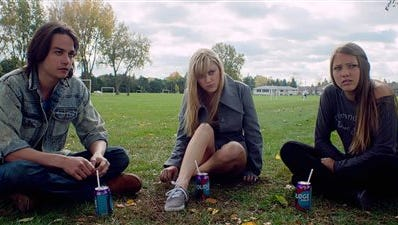"""This image released by RADiUS shows Daniel Zovatto, left, Maika Monroe and Lili Sepe in a scene from """"It Follows."""" (AP Photo/RADiUS)"""
