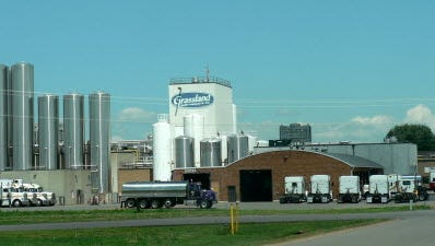 Grassland Dairy Products, of Greenwood, says it is canceling farm milk contracts because of the loss of Canadian business.