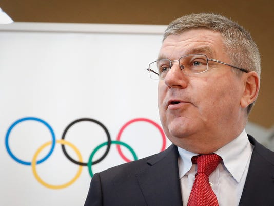 Thomas Bach, president of the International Olympic Committee (IOC) speaks to media during a photo call at Kuala Lumpur International Airport in Sepang, Malaysia, on Friday, July 24, 2015. Malaysia will host the 128th International Olympic Committee executive board meeting next week where the vote for the host cities of the 2022 Olympic Winter Games and for the 2020 Youth Olympic Winter Games will take place. (AP Photo/Vincent Thian)