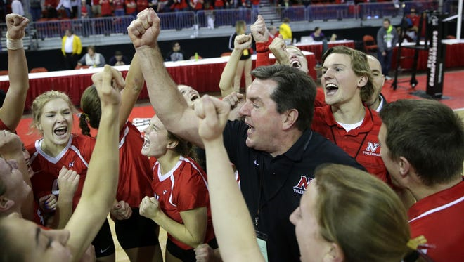 Neenah coach Bruce Moriarty celebrates with his team after the Rockets won the WIAA Division 1 state volleyball championship Saturday.
