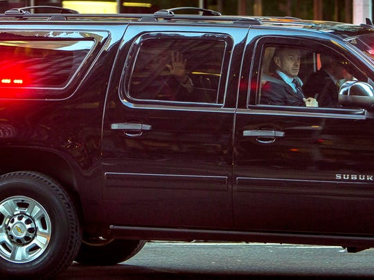 President-elect Donald Trump waves as he leaves Trump