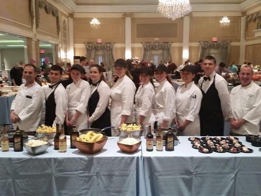 Students from the Culinary Arts Program at Somerset County Vocational & Technical High School showed off their talents at the 23rd Annual Taste of Somerset. The SCVTHS Culinary Arts students were among nearly 40 Somerset County restaurants that showed their skills and talents by preparing bananas foster and strawberry tiramisu at the event. The school has participated in the vent for more than 15 years. Proceeds from the Taste of Somerset benefit the non-profit, Bridgewater-based PeopleCare Center. Left to right: SCVTHS Instructor Chef John Vingara, senior SCVTHS student Carlos Cabral of Peapack, junior Amanda Lamperti of North Plainfield, junior Kayla Ryan of Bridgewater, junior Erin Kopecky of Bound Brook, senior Hanna Krilov of Bridgewater, senior Alyssa Simone of Basking Ridge, senior Ashley Hsu of Bridgewater, sophomore Kyle Liona of Hillsborough, and SCVTHS Instructor Chef Mark Mastrobattista.