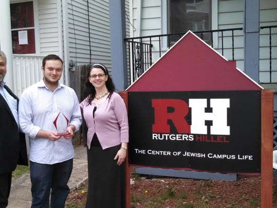 "Rutgers University Student Life presented its ""Outstanding Large Student Organization Award"" to Rutgers Hillel at the recent Annual Student Life ""Scarlets"" Award Ceremony. Left tor right are: Andrew Getraer, executive director of Rutgers Hillel; Seth Deneroff, outgoing Student Board president; and Rabbi Esther Reed, senior associate director."