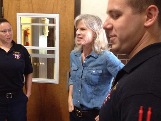 Democratic challenger Mary Burke (center) meets with firefighters at a fire station on Green Bay's west side.