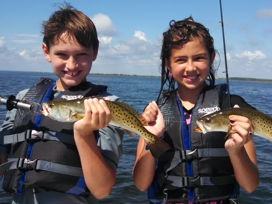 Jeff Naylor took his kids Lily and Peyton fishing on the St. Marks flats where they caught these trout on live shrimp.