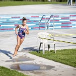 Teagen Flint begins her race on the Youth Short track at the RaceMT Triathlon by jumping into the Mitchell Pool at the Electric City Water Park on Sunday, August 2.