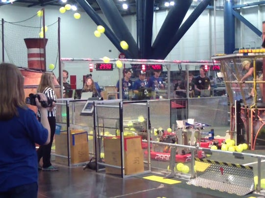 Hotwire Robotics-created Chaser, 2990, fires wiffle balls at its target during the steampunk competition of the First Robotics challenge held in Houston in April.