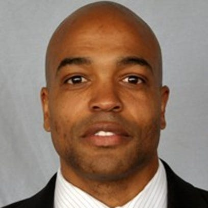 The head coach for Metro State University's Men's basketball