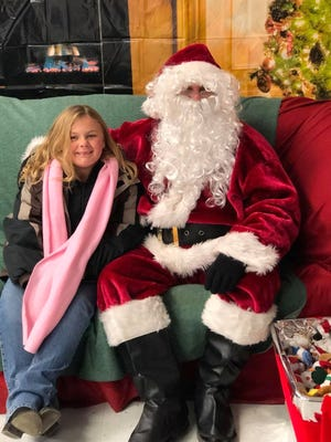 Santa stopped to talk to a friend at Ruidoso's annual Christmas in the Park, where lights are flipped on to decorate School House Park. The parks and recreation staff also put up lights in midtown , the village's other main park on Wingfield Street and some key locations.