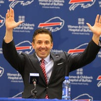 In  this file photo, Buffalo Bills president Russ Brandon shares a laugh during the press conference introducing Terry Pegula as the club's new owner.