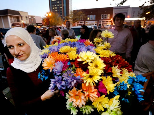 Murfreesboro Muslim Youth and others gather to promote peace and unity on the square in Murfreesboro on Nov. 18, 2016.