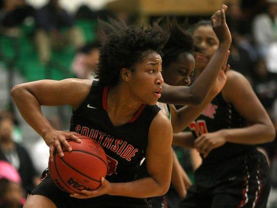 South Side's Cheyenne Cunningham (23) pulls in a rebound