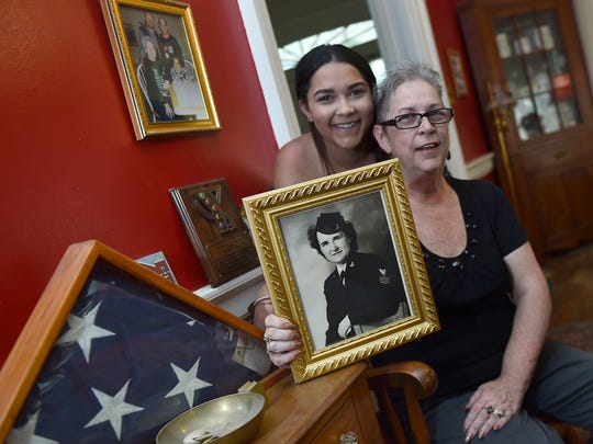 Sally Brooks, right, and her daughter, Monet, share a portrait of matriach Grace Gilbert Brooks on Thursday, June 15, 2017 at Sally Brooks' home on Norland Avenue, Chambersburg. Sally Brooks is donating $100.000 to the new FCCTC Practical Nursing building.