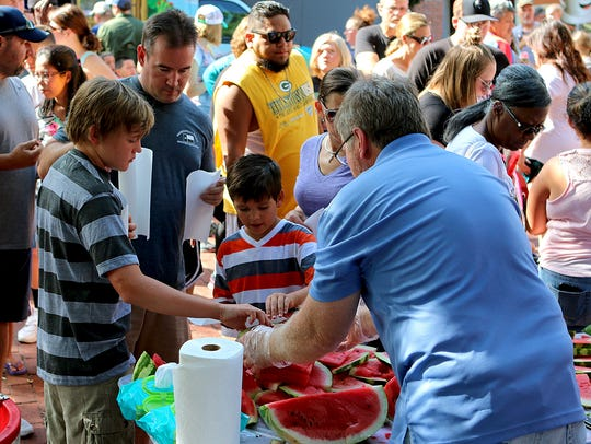 Visitors sample watermelons at the Wichita Falls Downtown