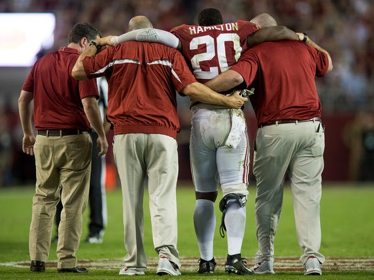Alabama linebacker Shaun Dion Hamilton (20) is helped off the field against LSU in second half action at Bryant Denny Stadium in Tuscaloosa, Ala. on Saturday November 4, 2017.