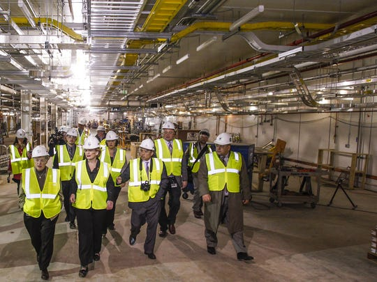 MSU President Lou Anna Simon, bottom left, Sen. Debbie Stabenow, D-MI, and others check out the progress of the rare isotope beam tunnel area Dec. 22, 2015, at MSU.