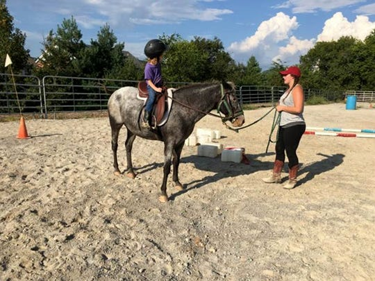 Campers learn horseback riding safety and posture, do arena work, navigate obstacle courses and go on trail rides at Tap Root Farm Life and Horseback Camp.