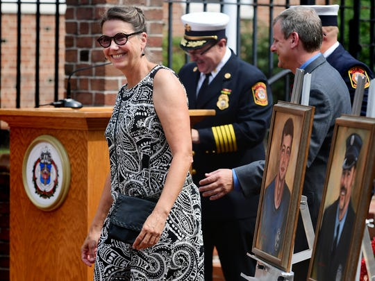 Painted portraits of fallen firefighters Ivan Flanscha and Zach Anthony by artist Carol Oldenburg of OMG Studios in York were on display during the York City Fire Department's awards ceremony at York City Hall Thursday, August 16, 2018. The two lost their lives fighting a fire at the former Weaver Organ and Piano building in March. Oldenburg was recognized during the ceremony. Bill Kalina photo