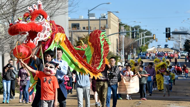 A dragon leads a parade down Pearl Street during the 2016 Chinese Spring Festival in Jackson.