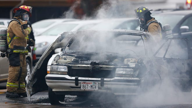 Wausau emergency crews respond to a vehicles caught on fire Monday morning at a parking lot near Eastbay on First Avenue in Wausau.