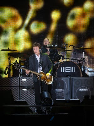 "Paul McCartney kicks off his set with ""Birthday"" as he performs for a large crowd at Firefly on Friday night."