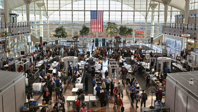 Passengers at Denver International Airport move through the Transportation Security Administration's main security checkpoint.