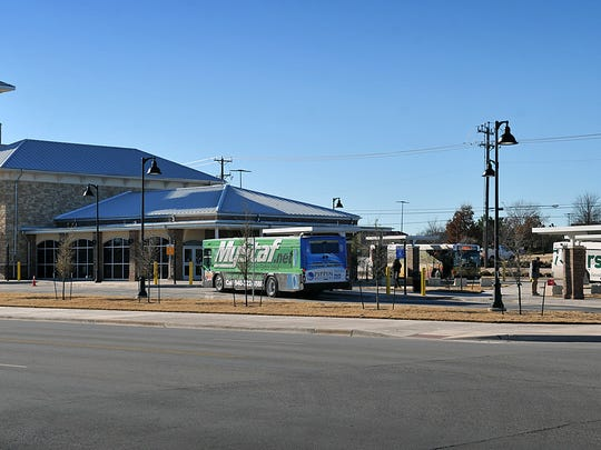 In this 2016 photo, city buses park at the Clarence Muehlberger Travel Center. Using grant funding, the city aims to create a climate-controlled area at the travel center with access to restrooms 24-hours a day.