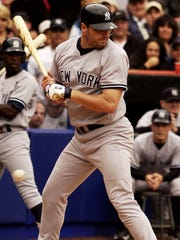 Yankees pitcher Roger Clemens stands in the batters