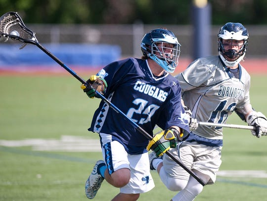 Bryce DiNardo, left, seen in this file photo is a key member of the senior-heavy MMU Cougars boys lacrosse team.