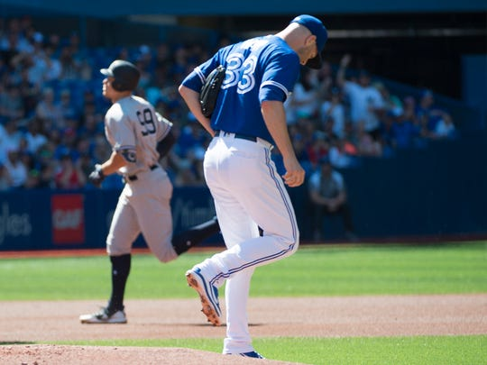 Jul 7, 2018; Toronto, Ontario, CAN; New York Yankees right fielder Aaron Judge (99) runs the bases after hitting a home run on Toronto Blue Jays starting pitcher J.A. Happ (33) during the first inning at Rogers Centre.