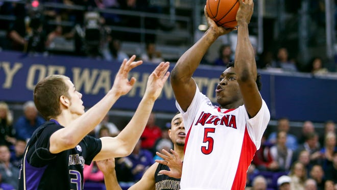 Stanley Johnson shoots against Washington during the second half at Alaska Airlines Arena.