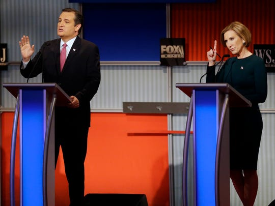 Ted Cruz speaks as Carly Fiorina tries to make a comment during a Republican presidential debate at the Milwaukee Theatre  Tuesday in Milwaukee.