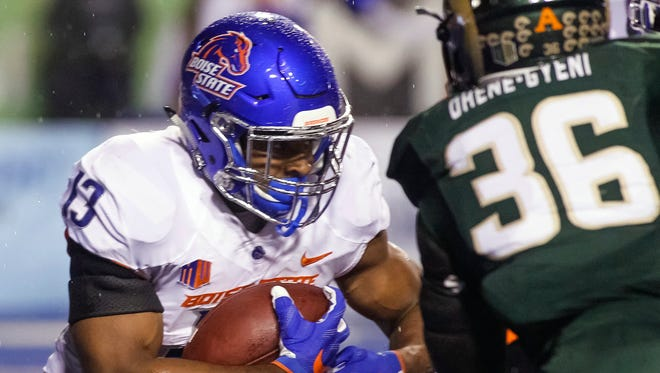 Boise State running back Jeremy McNichols (13) carries against Colorado State during the first half of an NCAA college football game in Boise, Idaho, on Saturday.
