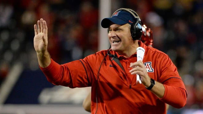 Nov 25, 2016; Tucson, AZ, USA; Arizona Wildcats head coach Rich Rodriguez celebrates after scoring a touchdown against the Arizona State Sun Devils during the fourth quarter of the Territorial Cup at Arizona Stadium. The Wildcats won 56-35. Mandatory Credit: Casey Sapio-USA TODAY Sports
