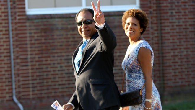 Wilmington Mayor Dennis P. Williams and wife Shayne vote on primary Election Day at Harlan Elementary School Tuesday morning. Williams faced a crowded field in a bid for a second term.